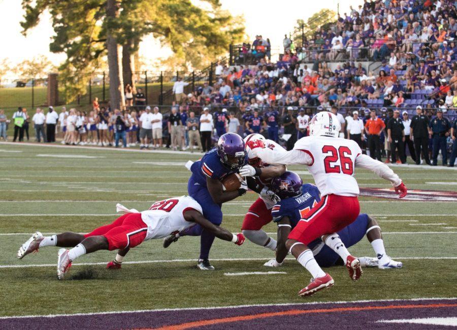 A demon pummels through the  Lamar defense to score a touchdown Photo credit: Sean Mcgraw