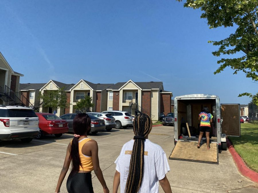 Tana Gray (left), Yoland Bellard (middle) and Alicia Waterstract (right) start moving in for a new year at Northwestern State University of Louisiana.