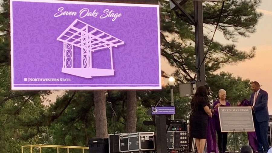 Student Government Association  President Tajh Edwards,  National Pan-Hellenic Council President Coby McGee, Doris Ann Roque-Robinson and Interim President Marcus Jones unveil the Seven Oaks Stage plaque.
