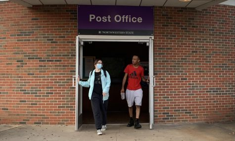 Skye Howard and Kamarreo Jernigan leaving NSU Post Office after using the new services available inside.