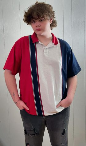 Kevin Thomas showcasing an easy way to wear a striped pattern shirt without overwhelming your outfit.