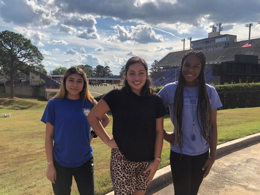 Samantha Martinez on the left, Wendy Martinez-Ortega in the middle and Jalynn LuBom on the right are ready to support Demon football.