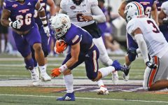 Gavin Landry, wide receiver for Northwestern State University of Louisiana, breaks through tackles and edges a first down against the University of Tennessee at Martin.